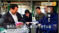 株式会社エルエーピーの取締役:平野淳がマスタースレーブ式パワーアシストハンドの改善点を説明している写真