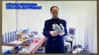 パワーアシストハンドの生みの親、神奈川工科大学 先進技術研究所の山本圭治郎教授が最初に開発したパワーアシストハンドを紹介している写真